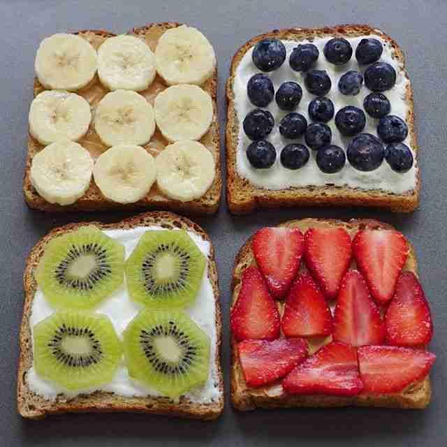 Four kinds of toast - banana, blueberry, kiwi and strawberry