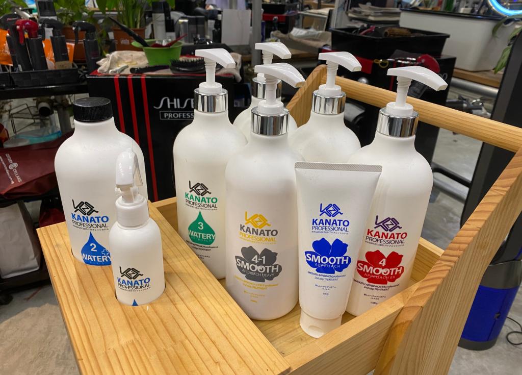 Bottles of hair treatment in a wooden cart