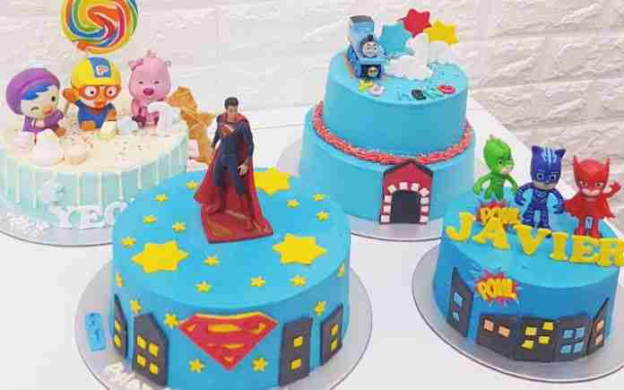 instagrammable array of cartoon fondant cakes featuring Poror, Superman, Thomas the Train and PJ Masks