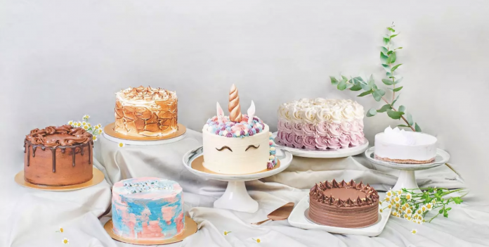 7 decorated cakes placed on a table
